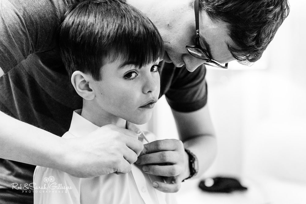 Groom helps son get ready for wedding