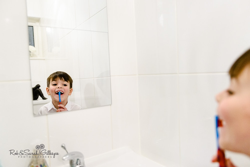 Pageboy brushes teeth before wedding ready for wedding