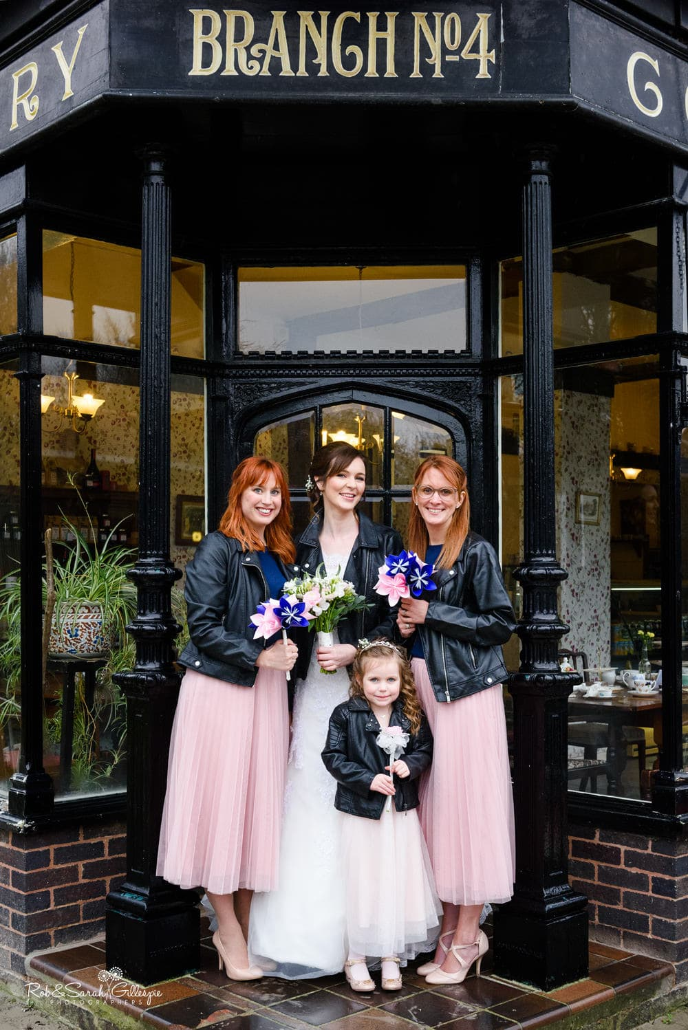 Bride, bridesmaids and flowergirl group photo at Avoncroft Museum