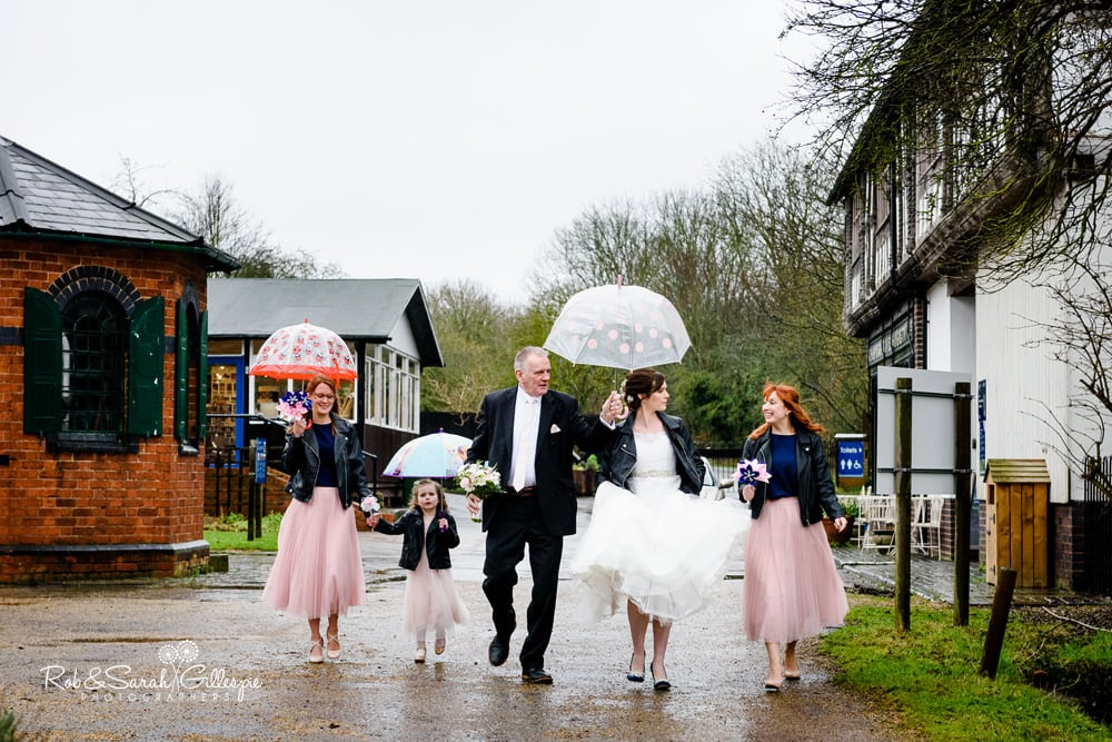 Bride and bridesmaids walk through Avoncroft Museum