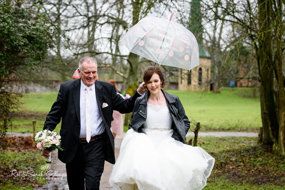 Bride and father walk to wedding blessing at Avoncroft Museum