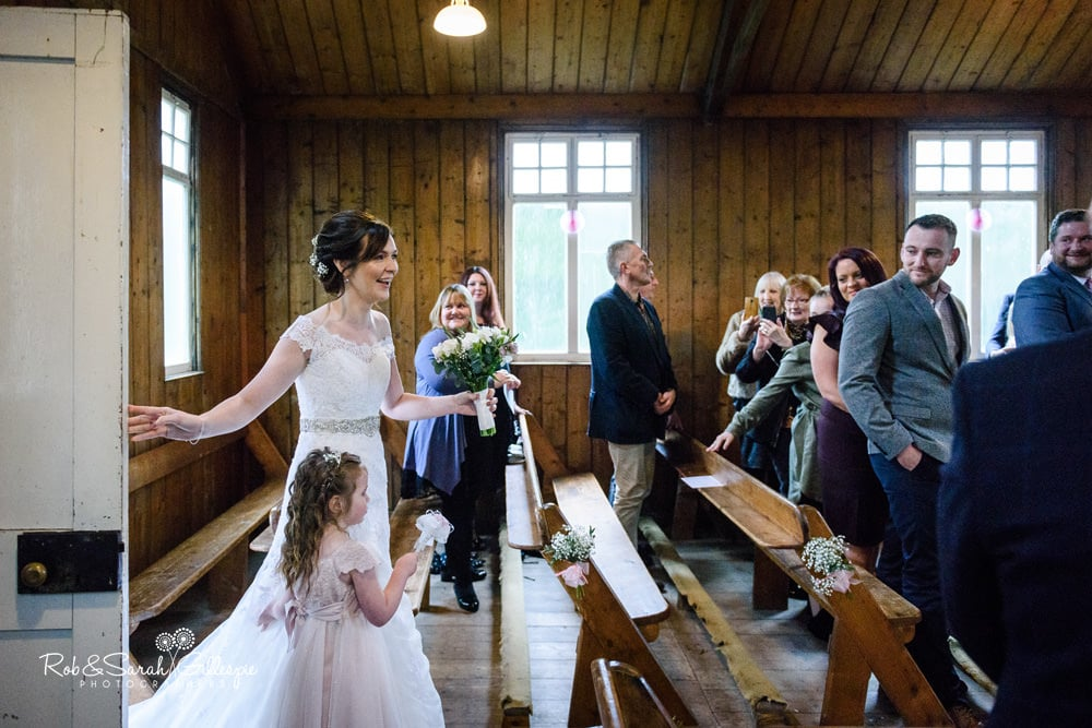 Bride and flowergirl enter Mission Church at Avoncroft Museum