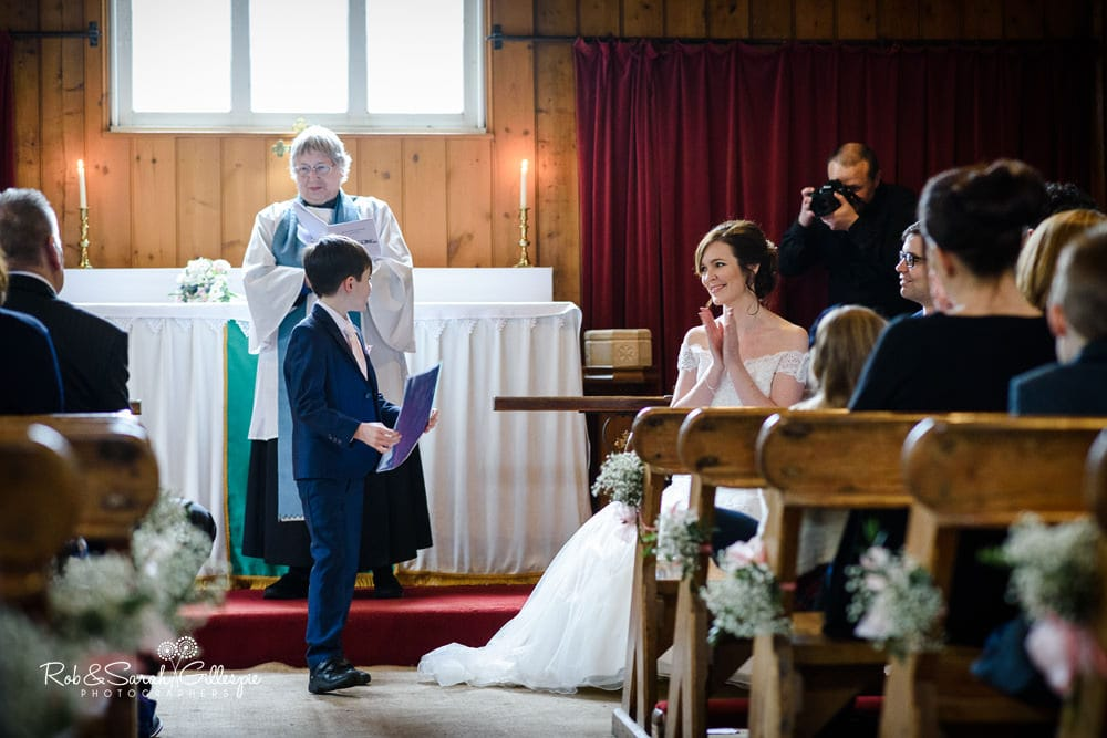 Pageboy gives reading at wedding blessing in Mission Church at Avoncroft Museum