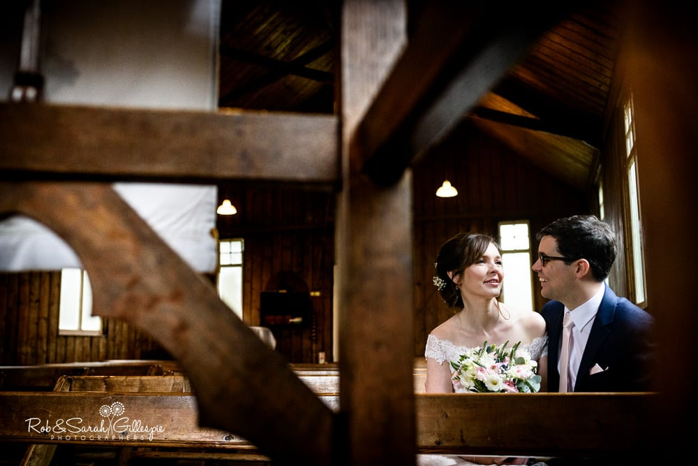 Bride and groom together inside Mission Church at Avoncroft Museum