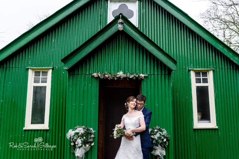 Bride and groom together outside Mission Church at Avoncroft Museum