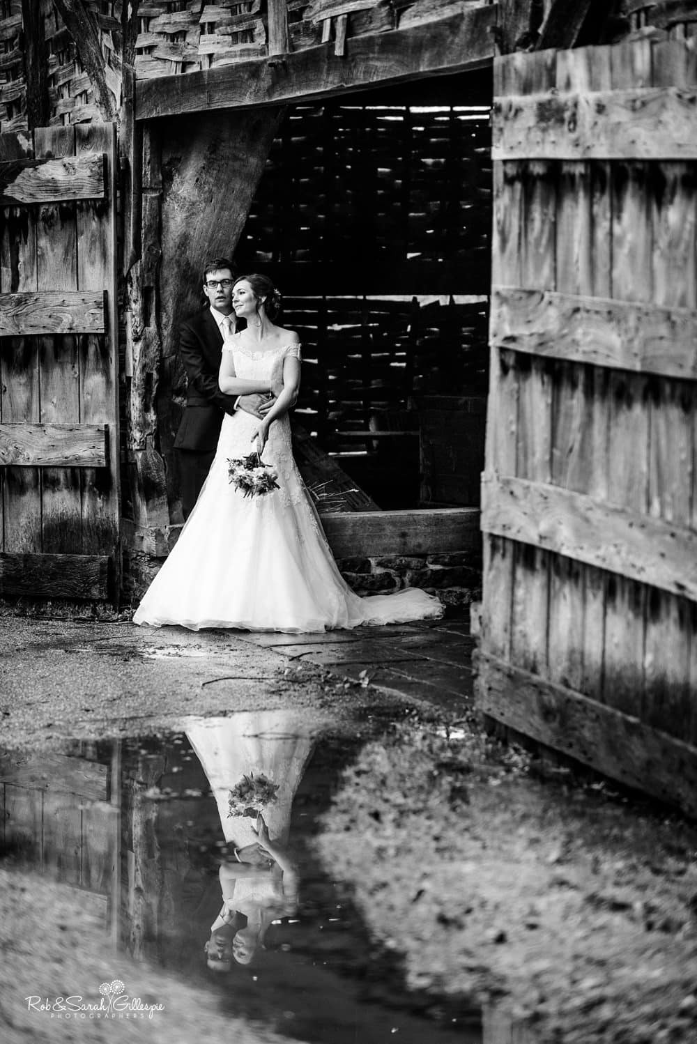 Bride and groom in Threshing Barn at Avoncroft Museum