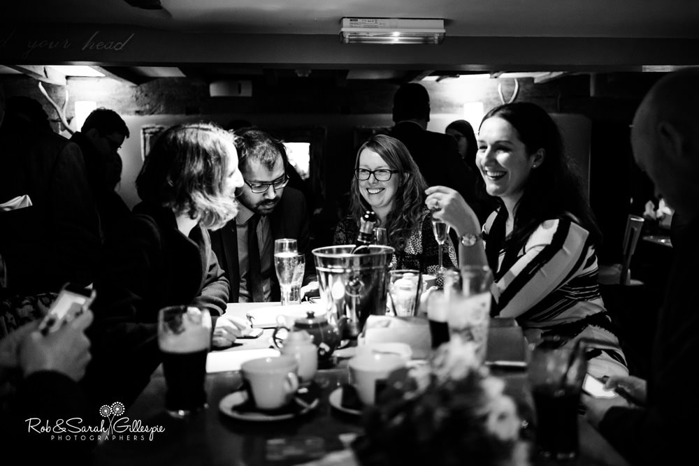Wedding guests chat over drinks at The Vernon pub in Hanbury, Worcestershire