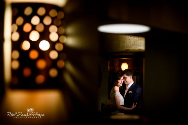 Bride and groom together inside old pub with beautiful light
