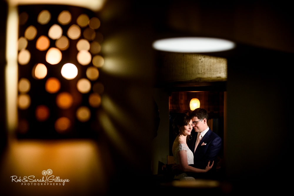 Bride and groom together at The Vernon pub in Hanbury in beautiful light