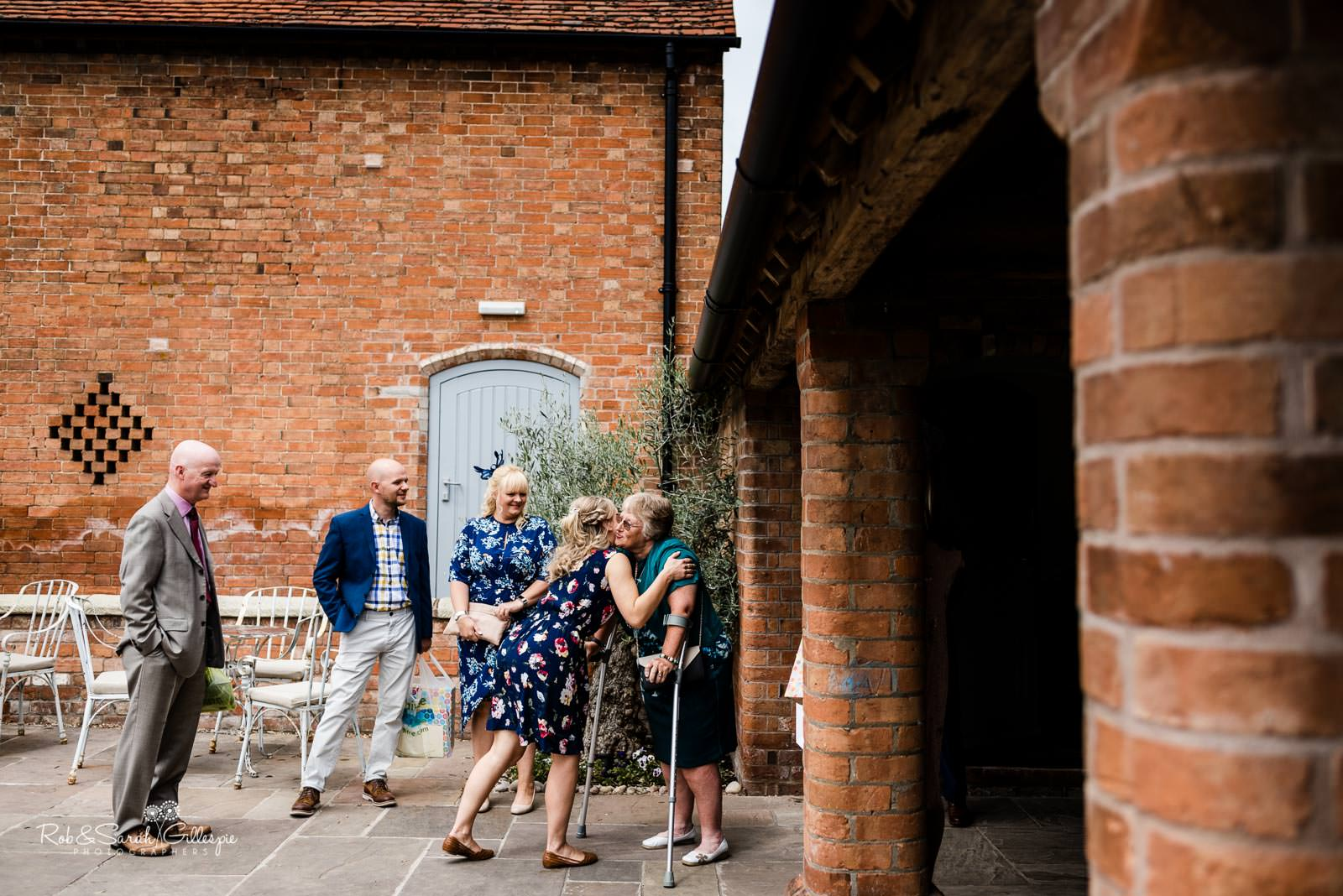Bridesmaids greets wedding guests at Swallows Nest Barn