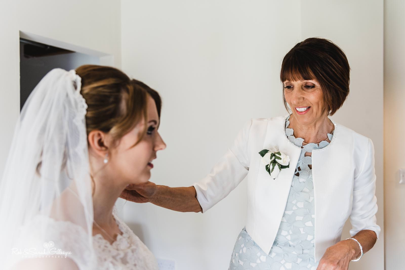 Bride and mum get ready for wedding at Swallows Nest Barn