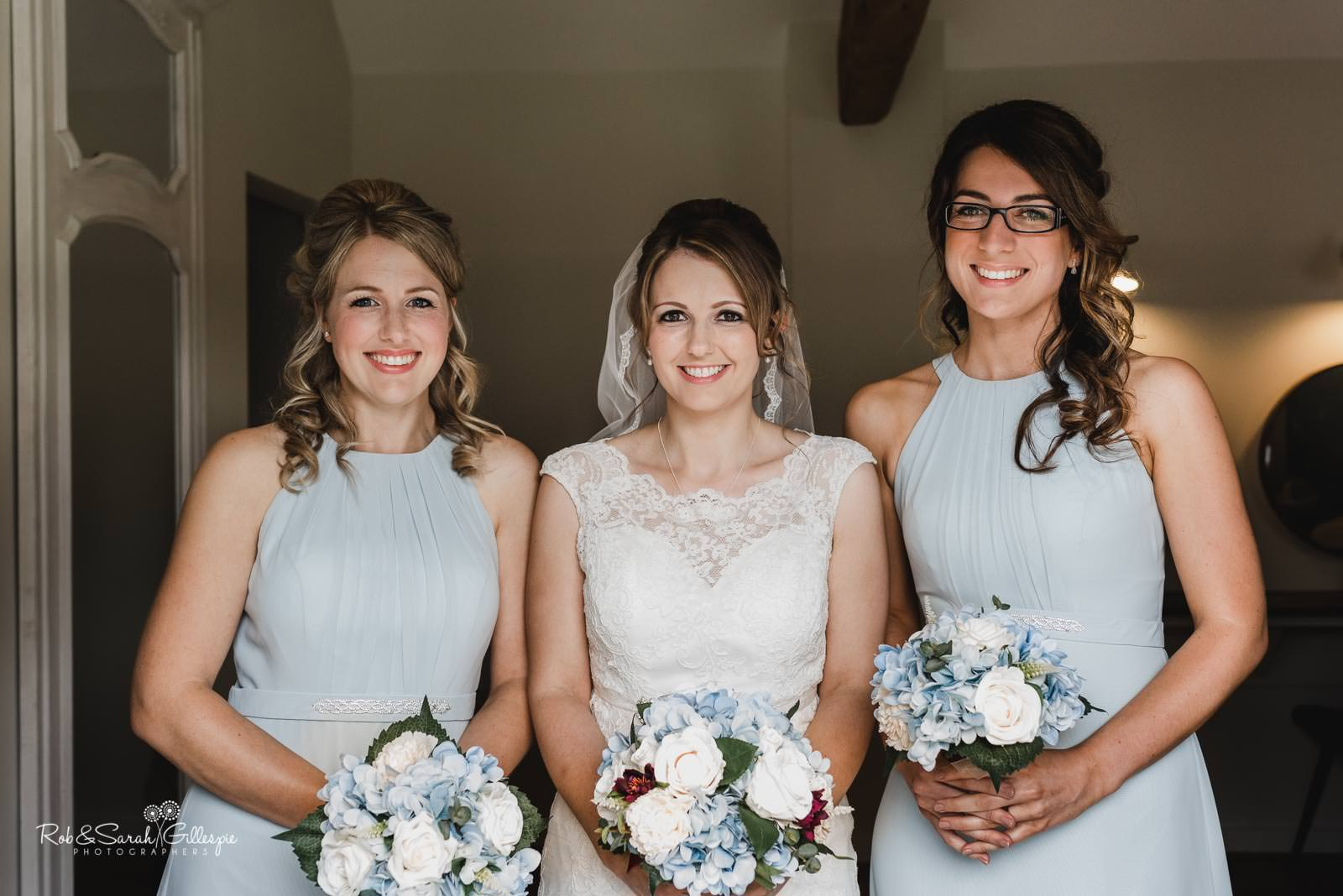 Bride and bridesmaids group photo at Swallows Nest Barn