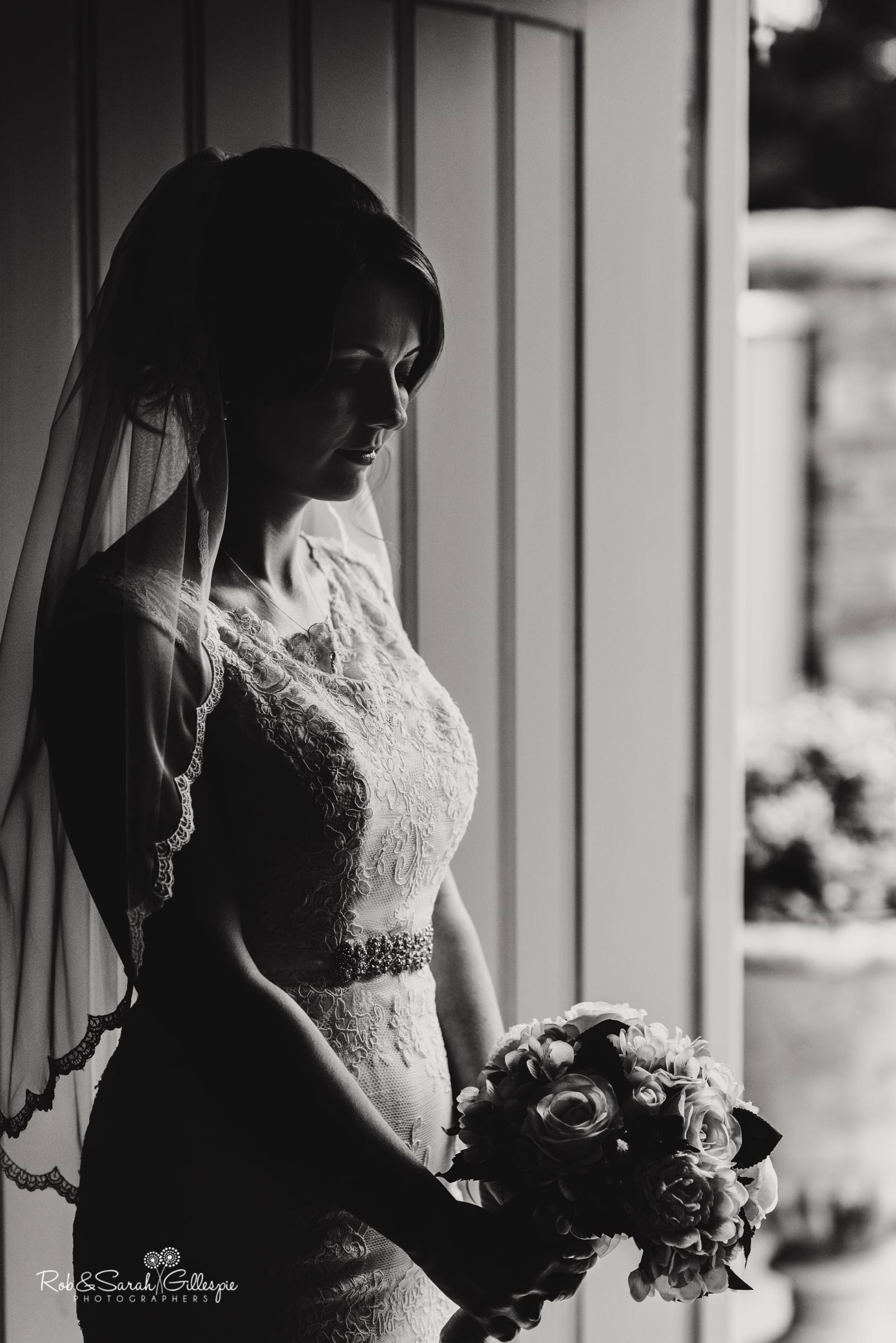 Portrait of bride in doorway at Swallows Nest Barn wedding