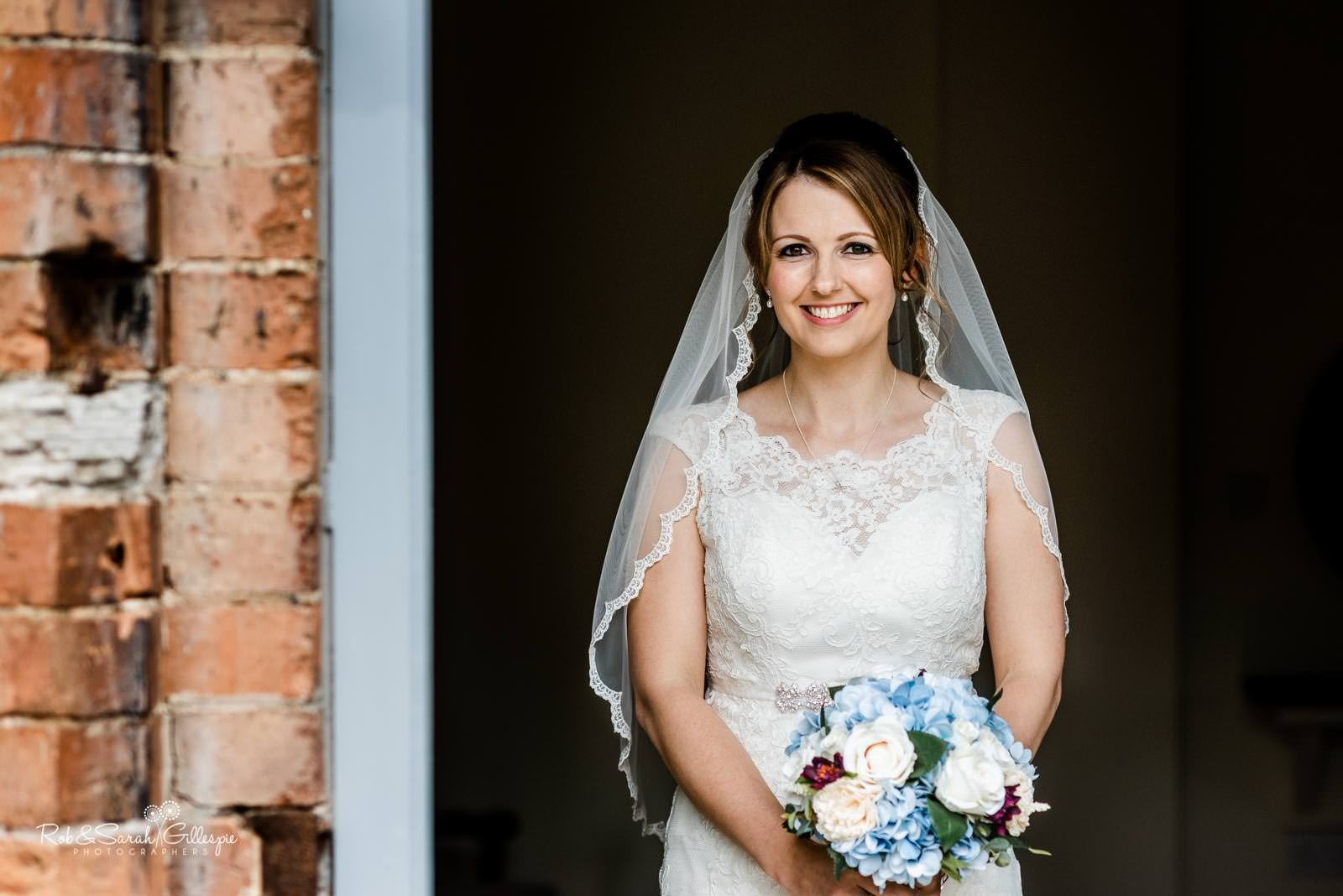 Beautiful portrait of bride in doorway at Swallows Nest Barn wedding