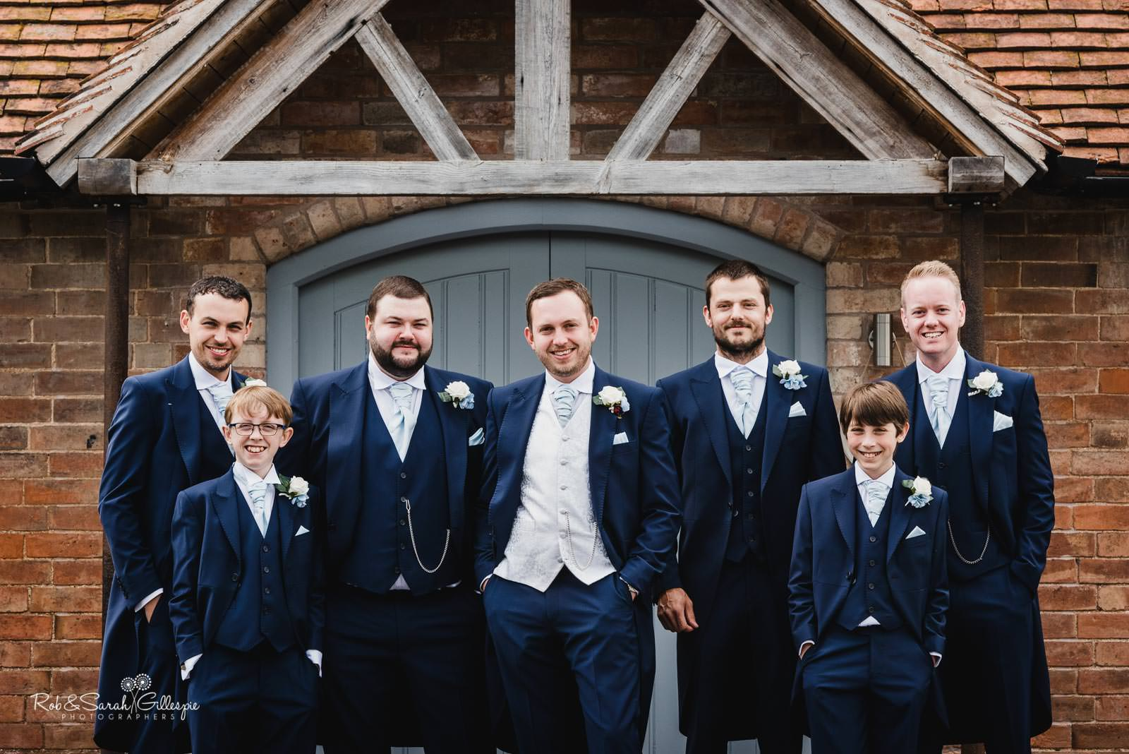 Group photo of groom and groomsmen at Swallows Nest Barn wedding