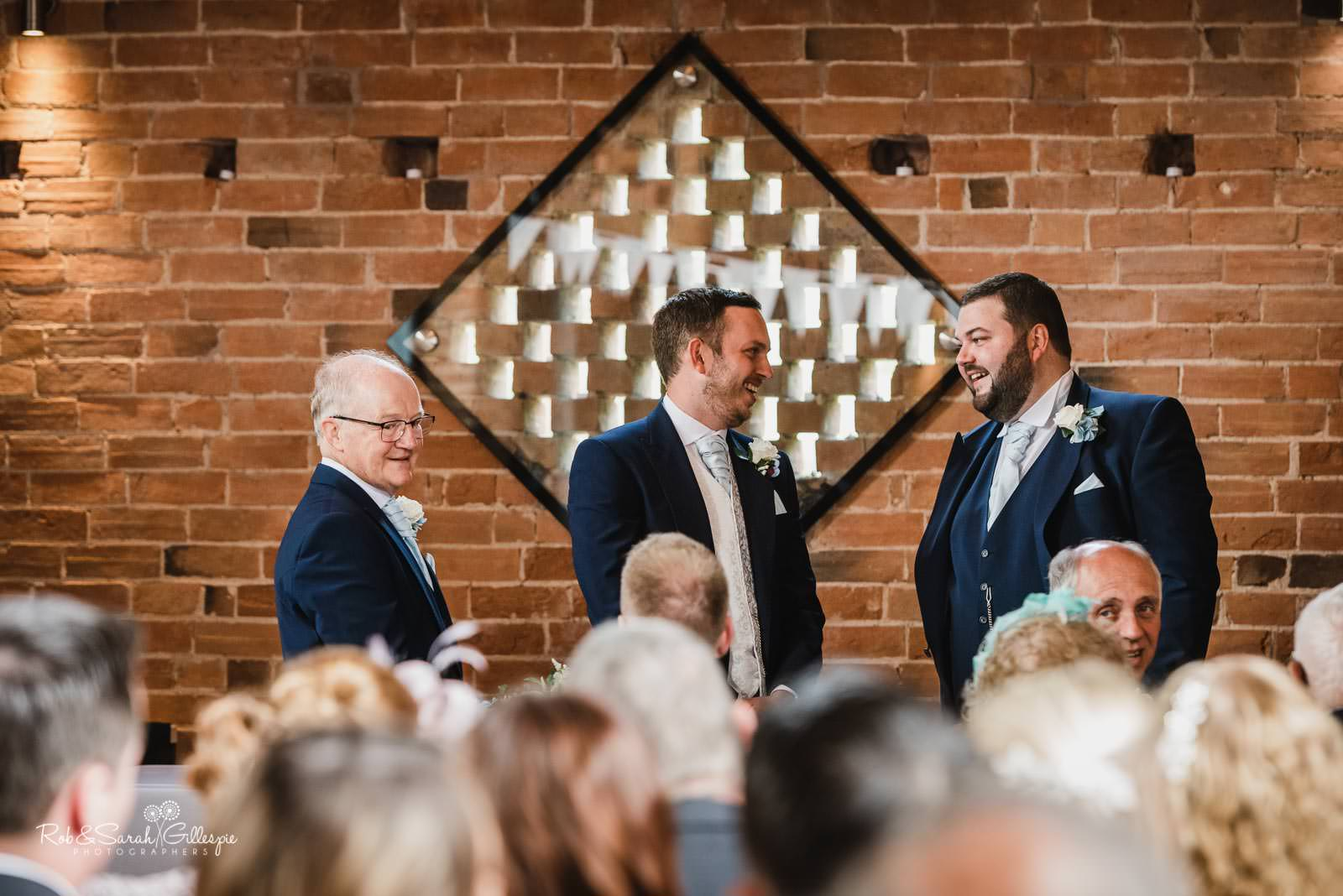 Groom, best man and dad chat before wedding at Wedding ceremony at Swallows Nest Barn