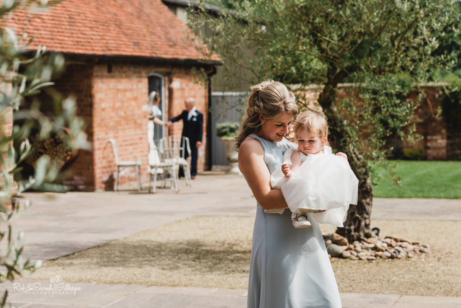 Bridesmaid and flowergirl at Wedding ceremony at Swallows Nest Barn