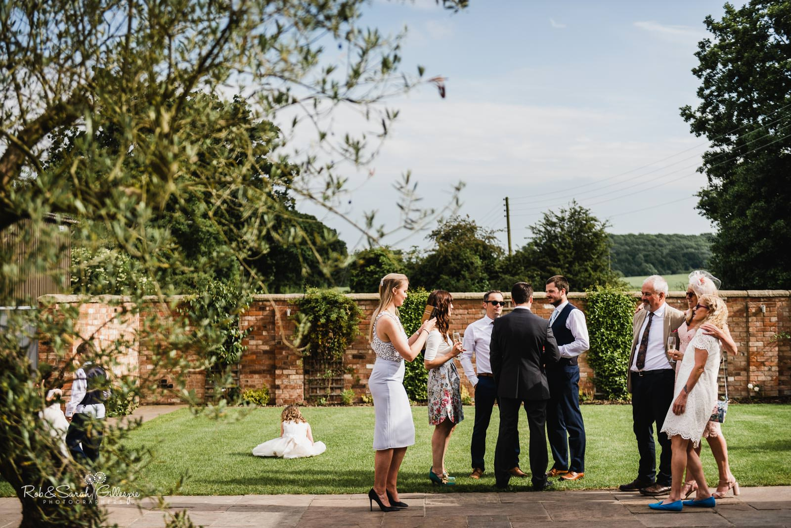 Guests relaxing at Swallows Nest Barn wedding