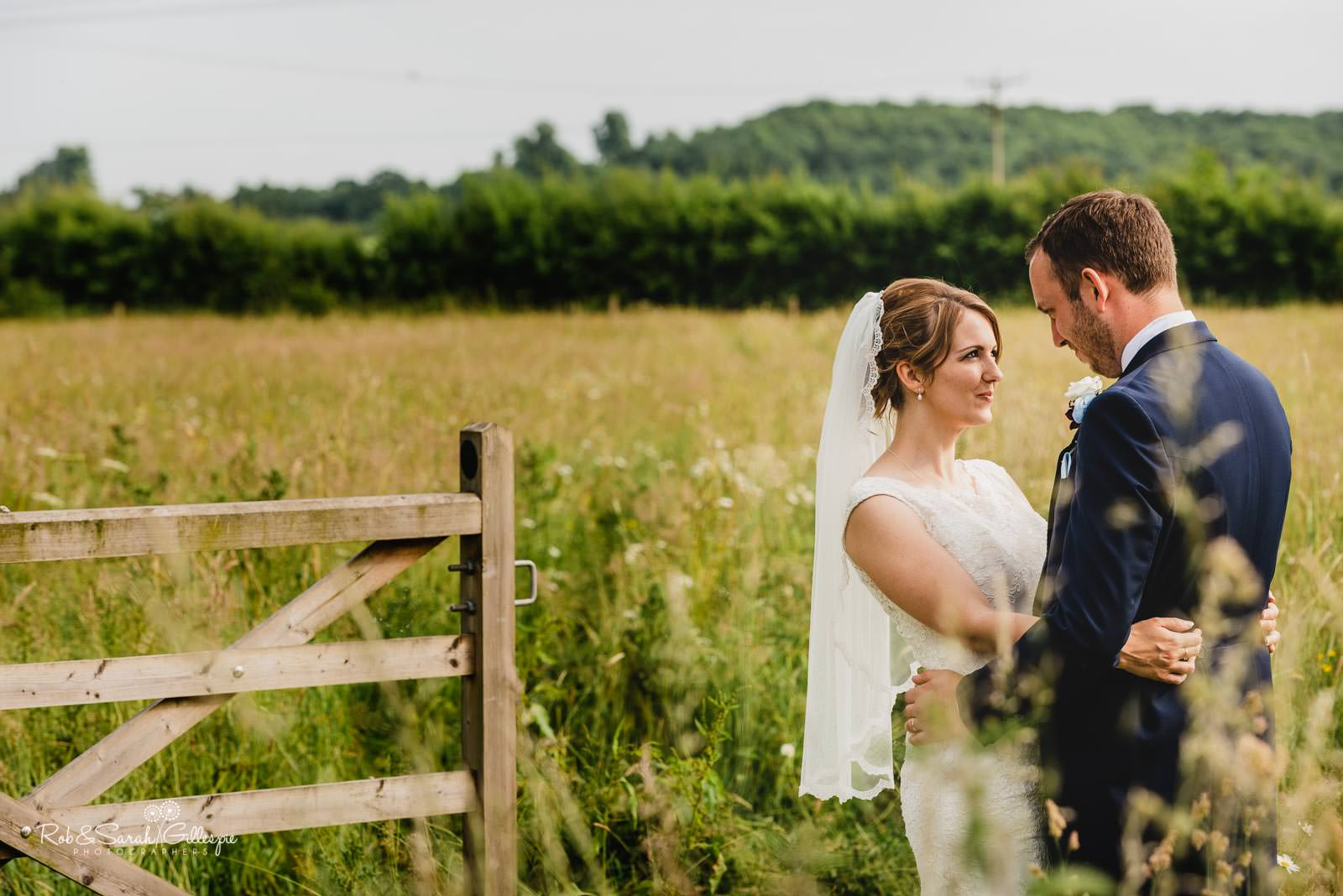 Bride and groom couple photographs at Swallows Nest Barn