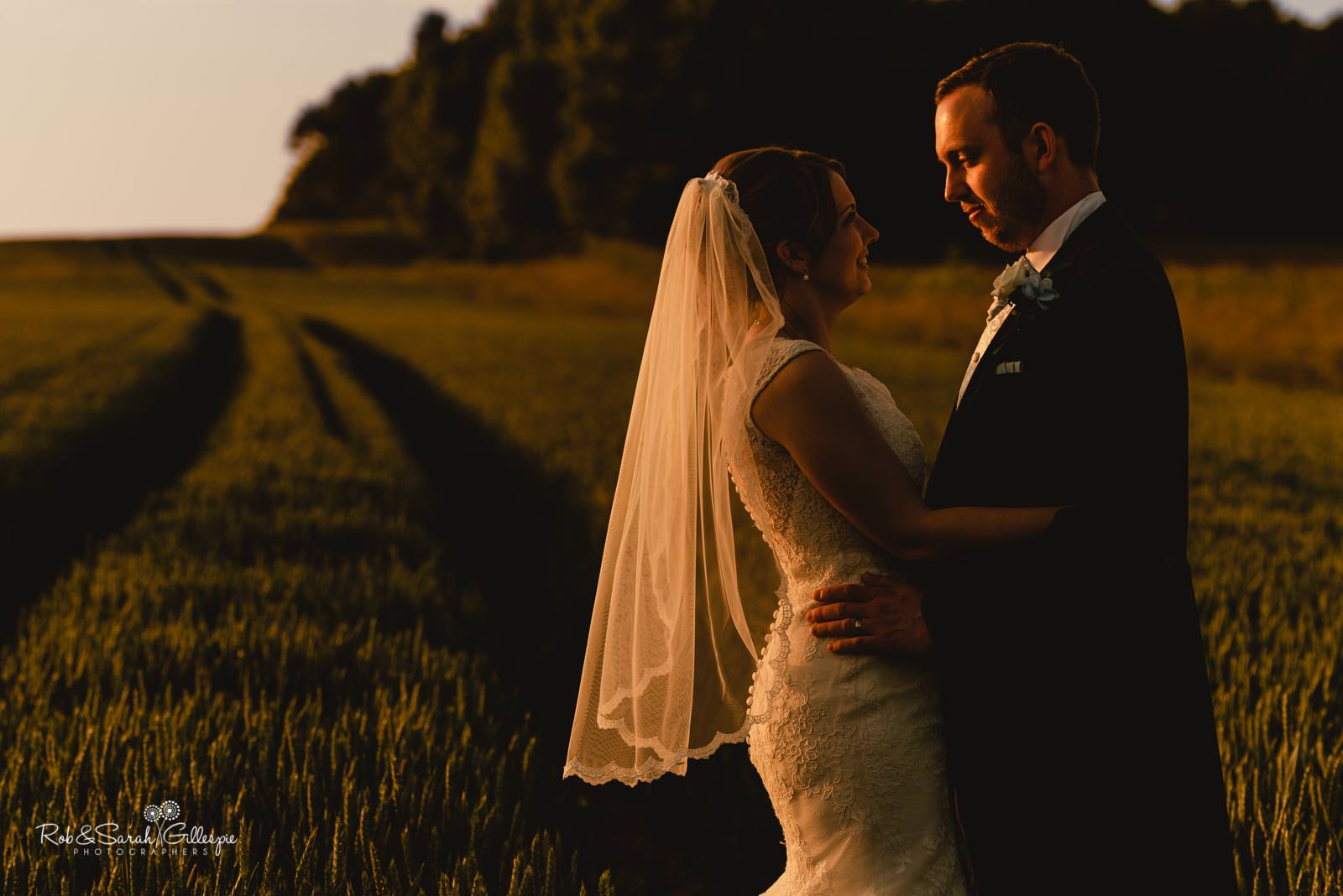 Bride and groom in beautiful evening light at Swallows Nest Barn