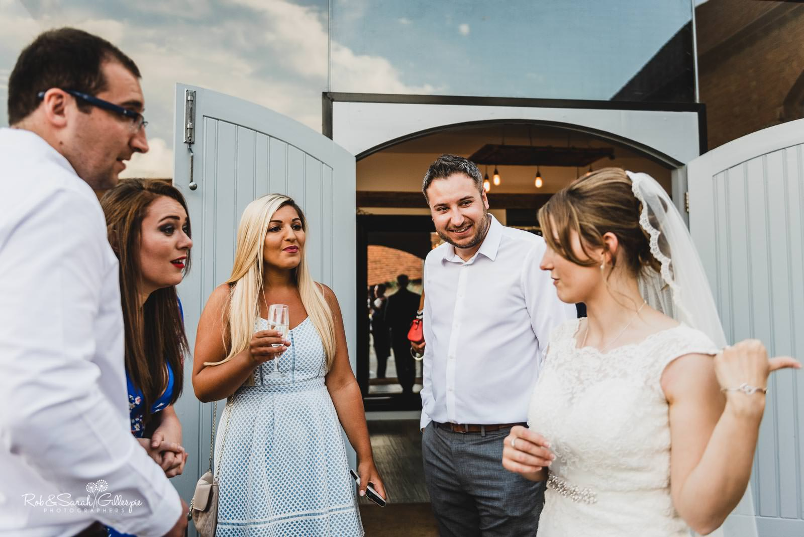 Bride and guests at Swallows Nest Barn wedding
