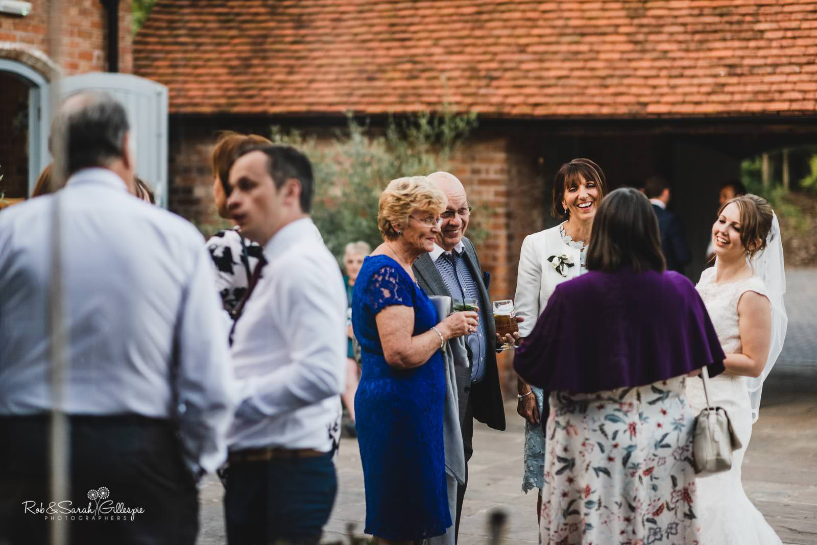 Bride and guests chatting at Swallows Nest Barn