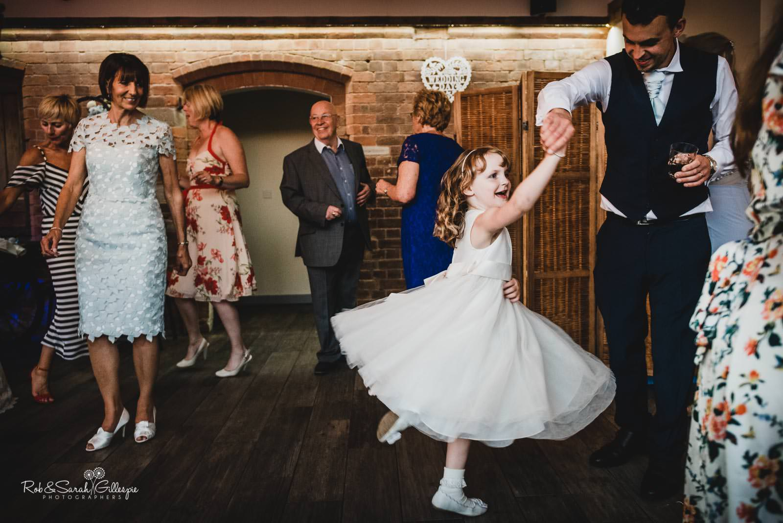 Wedding guests dancing at Swallows Nest Barn