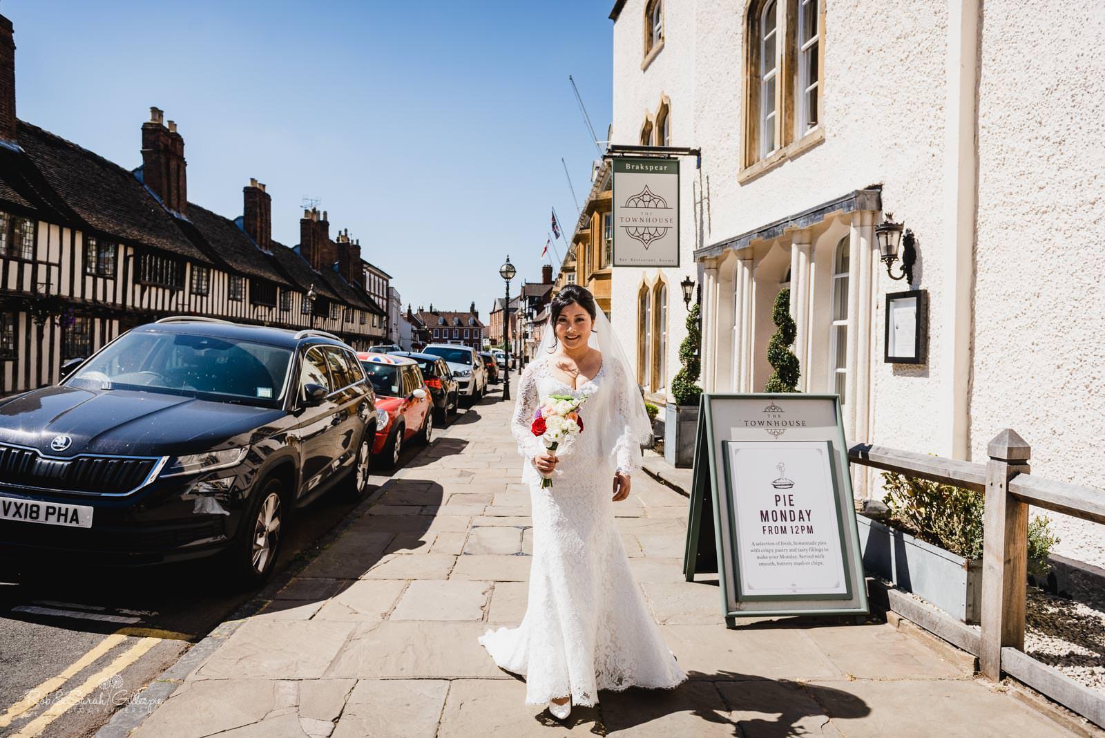 Bride and friends walk through Stratford upon Avon