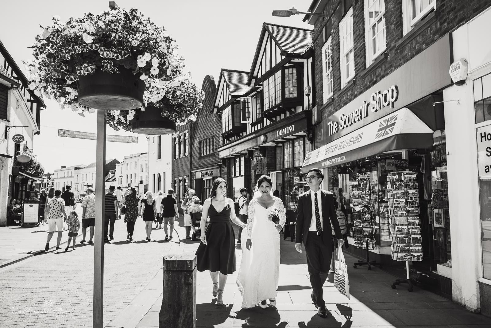 Bride and friends walk through Stratford upon Avon