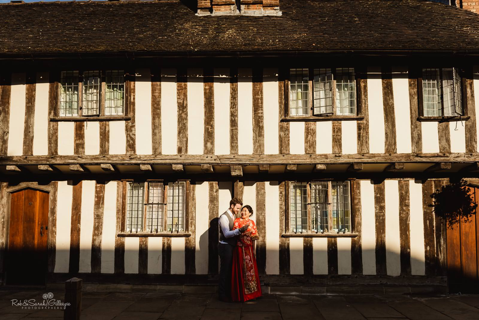 Bride and groom in front of old building in Stratford upon Avon