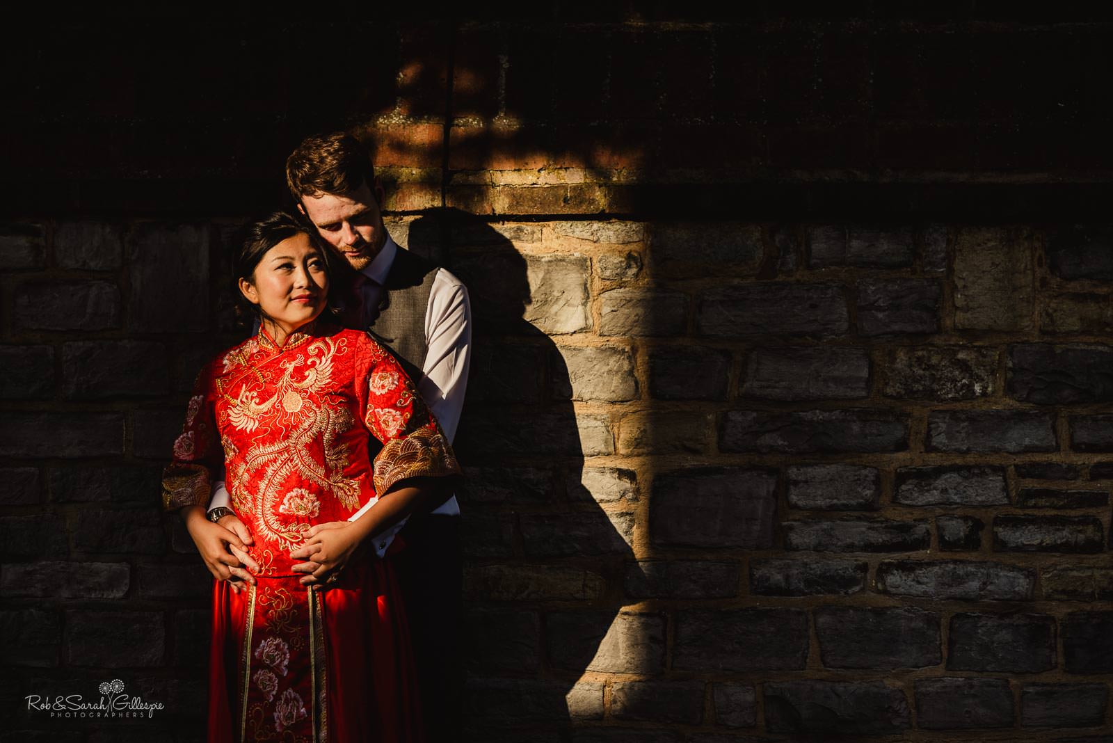 Bride and groom in dramatic evening light