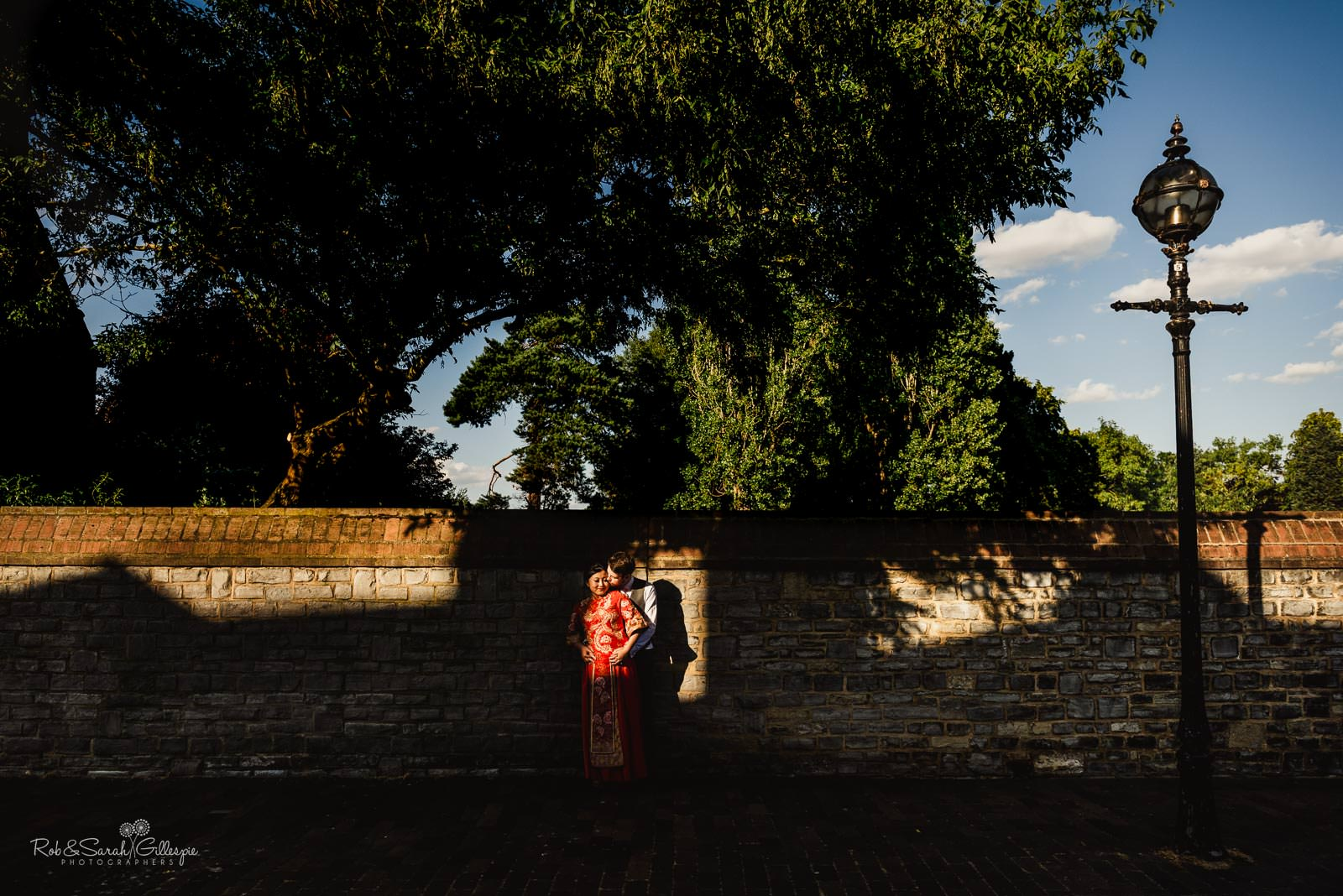 Bride and groom in dramatic light in Stratford upon Avon