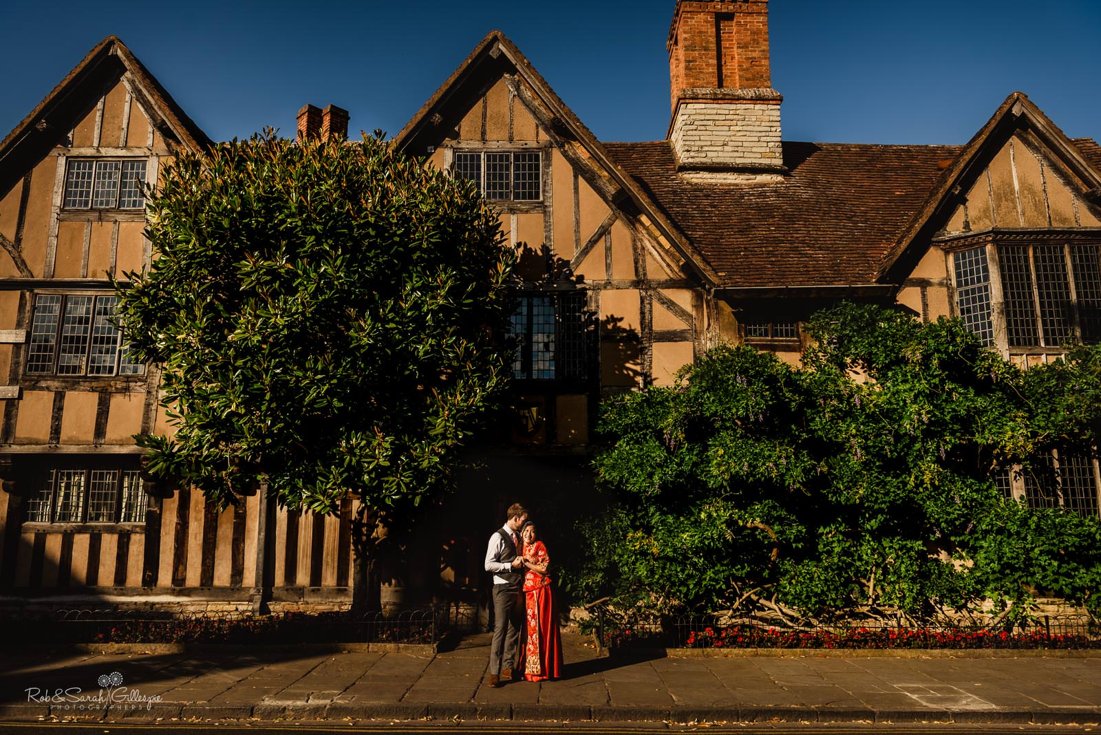 Bride and groom outside old building in Stratford upon Avon