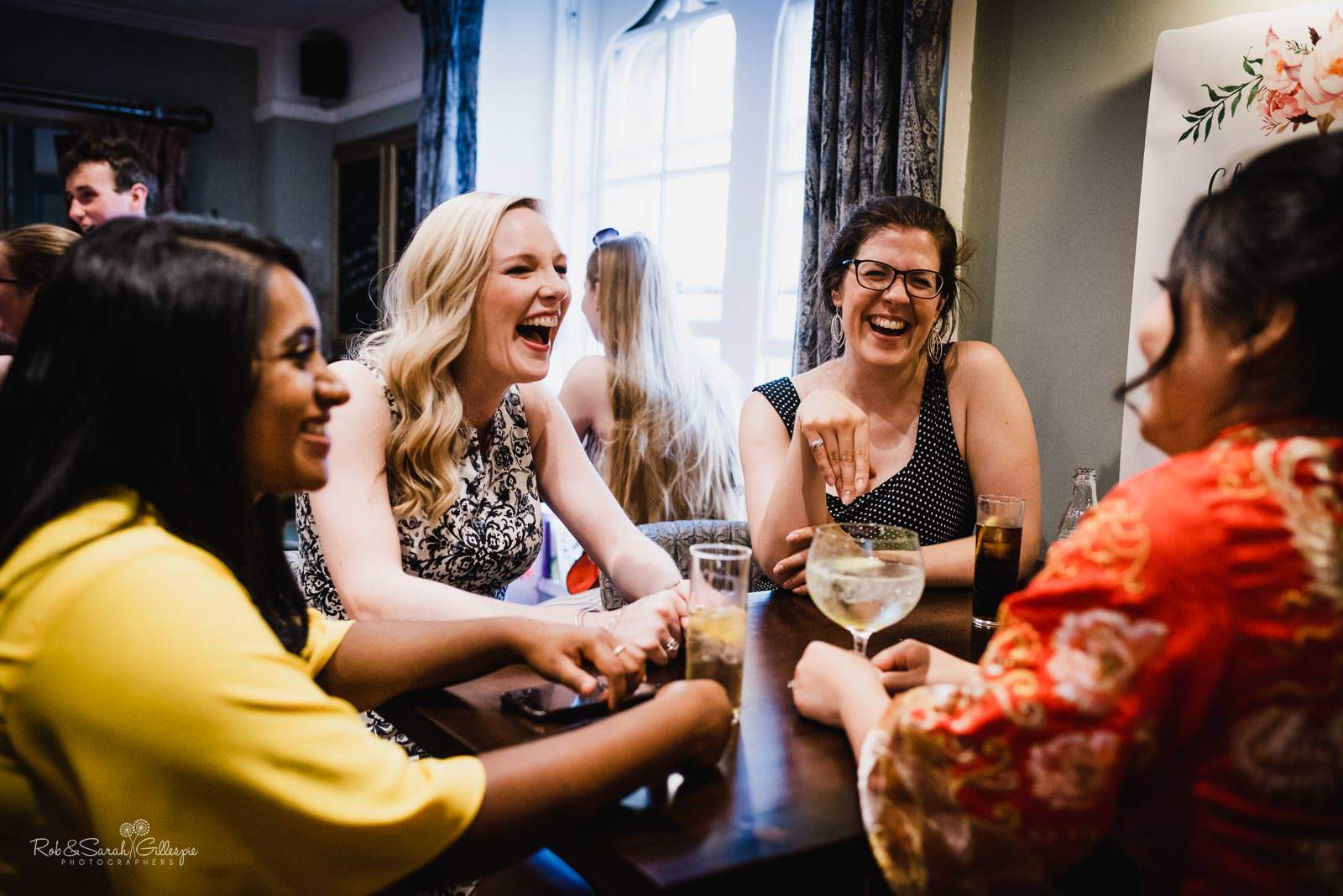 Wedding guests relaxing at The Townhouse in Stratford upon Avon