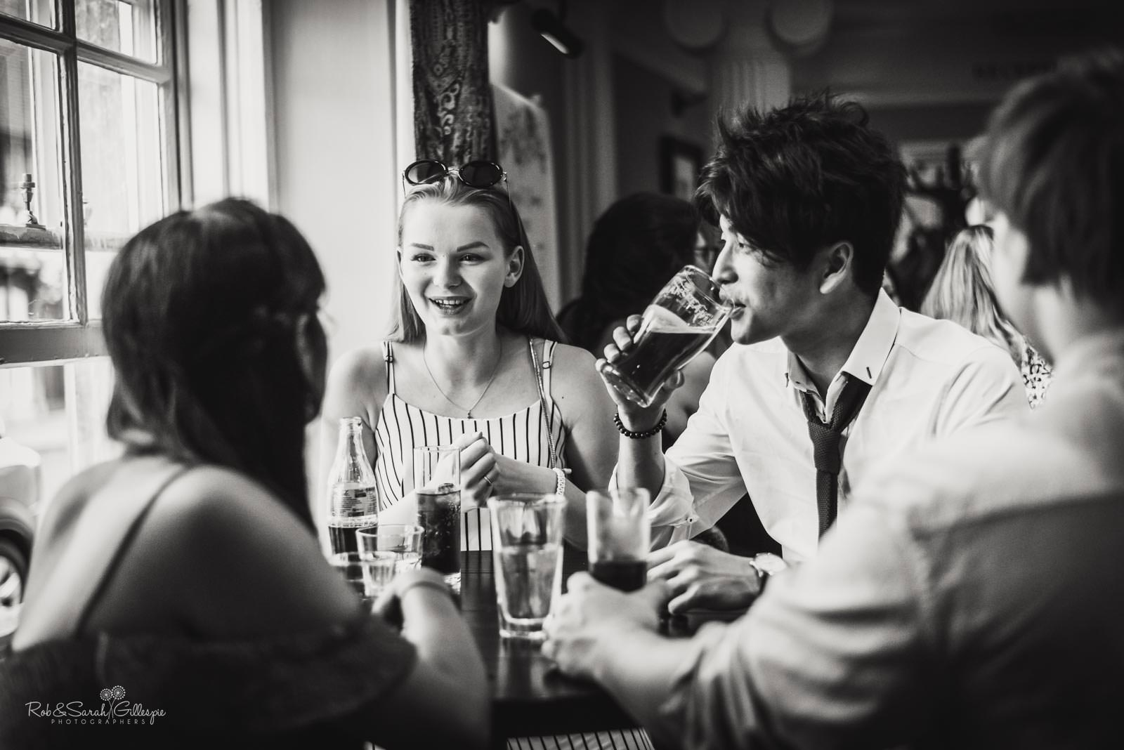 Natural photography of wedding guests relaxing at Townhouse in Stratford upon Avon