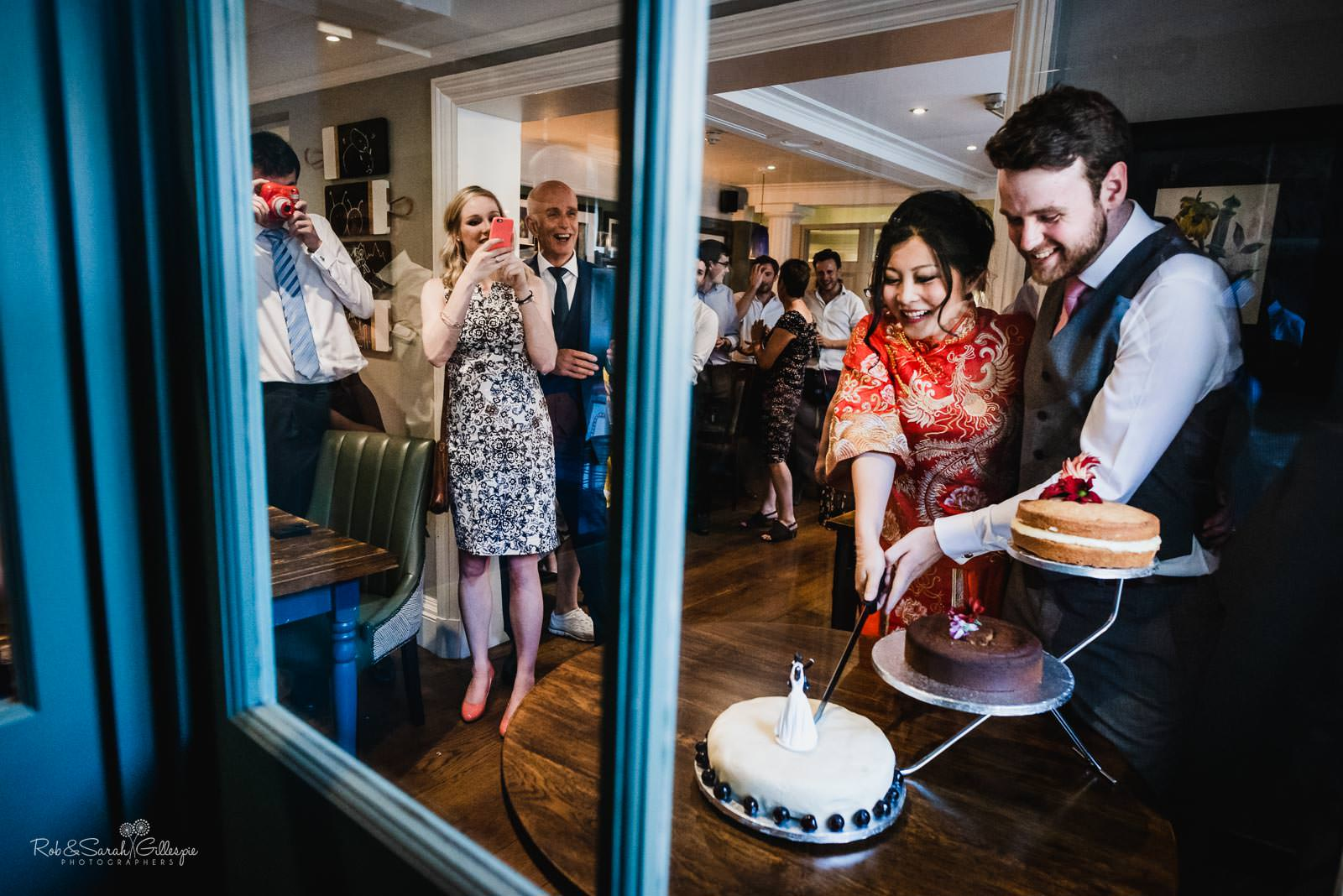 Bride and groom cut wedding cake at Stratford upon Avon Townhouse