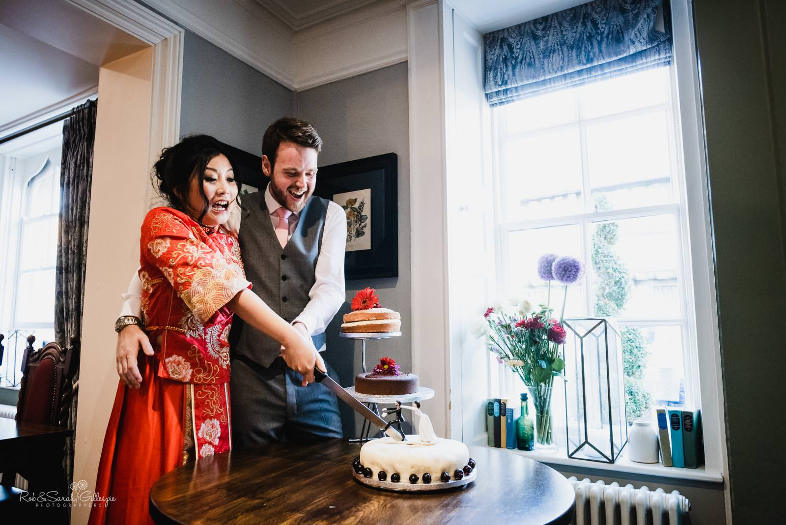 Bride and groom cut cake at Stratford upon Avon wedding