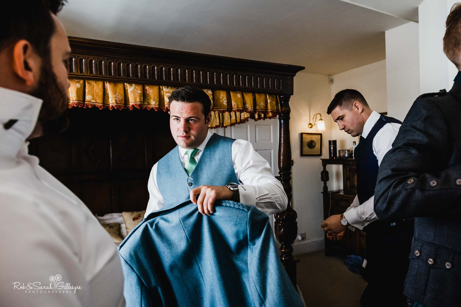 Groom and friends get ready for wedding at Wethele Manor in Warwickshire