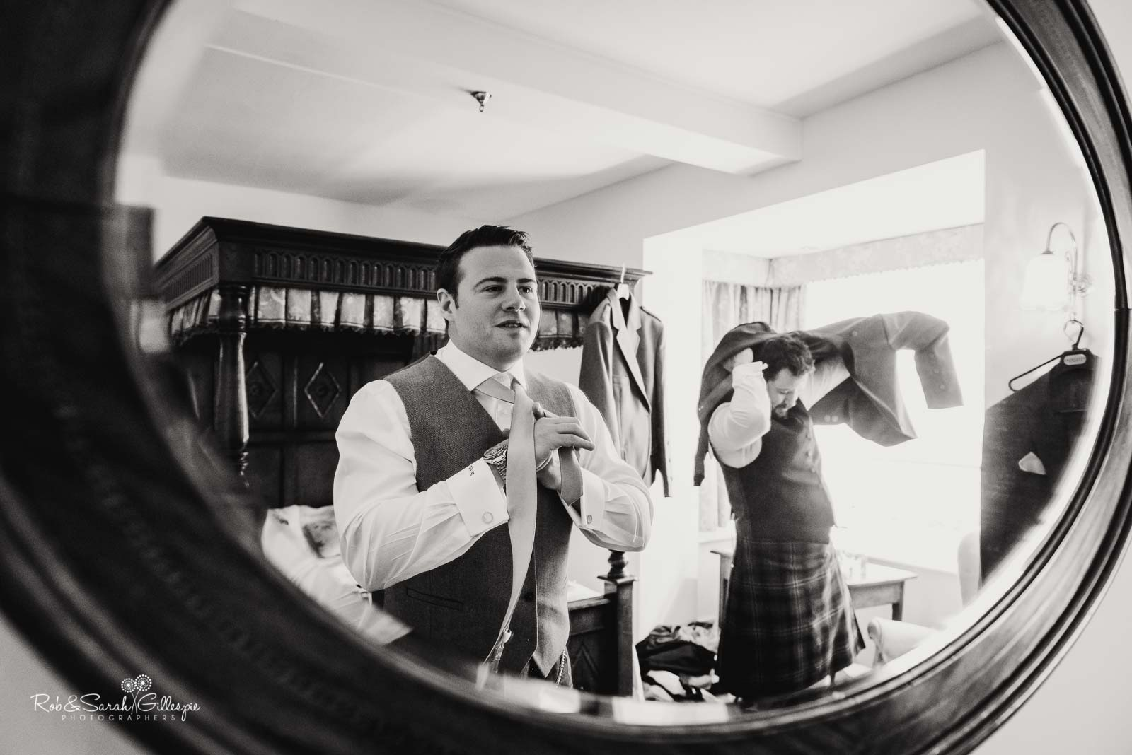 Groom and friends prepare for wedding at Wethele Manor