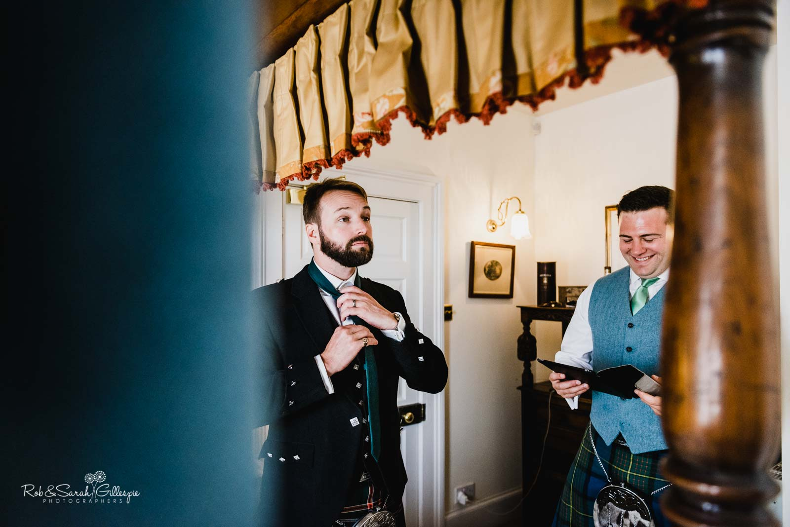 Groom preparations for wedding at Wethele Manor