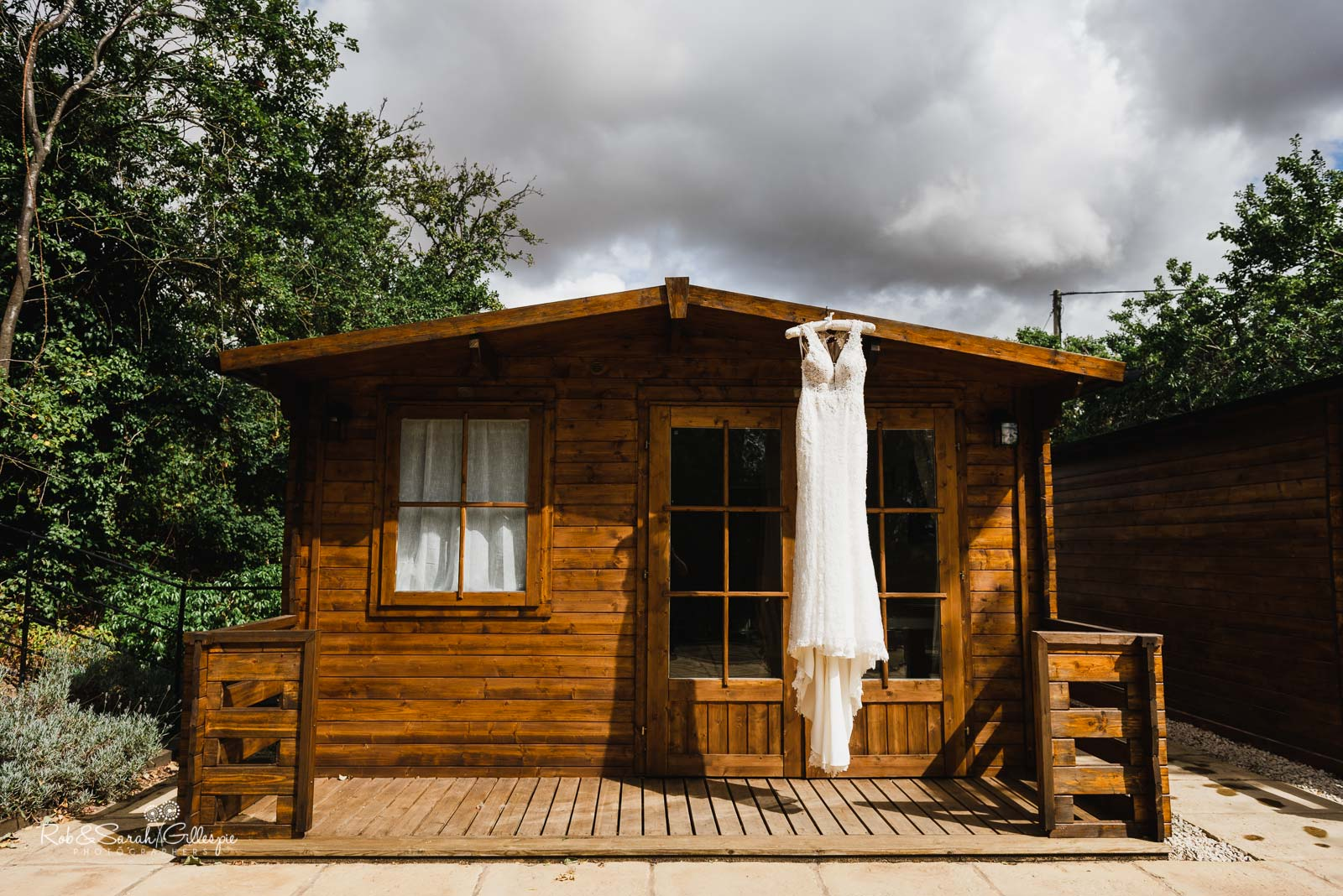 Wedding dress hanging from chalet at Wethele Manor