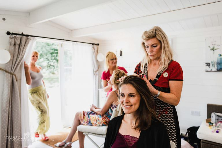 Bride has hair styled in chalet