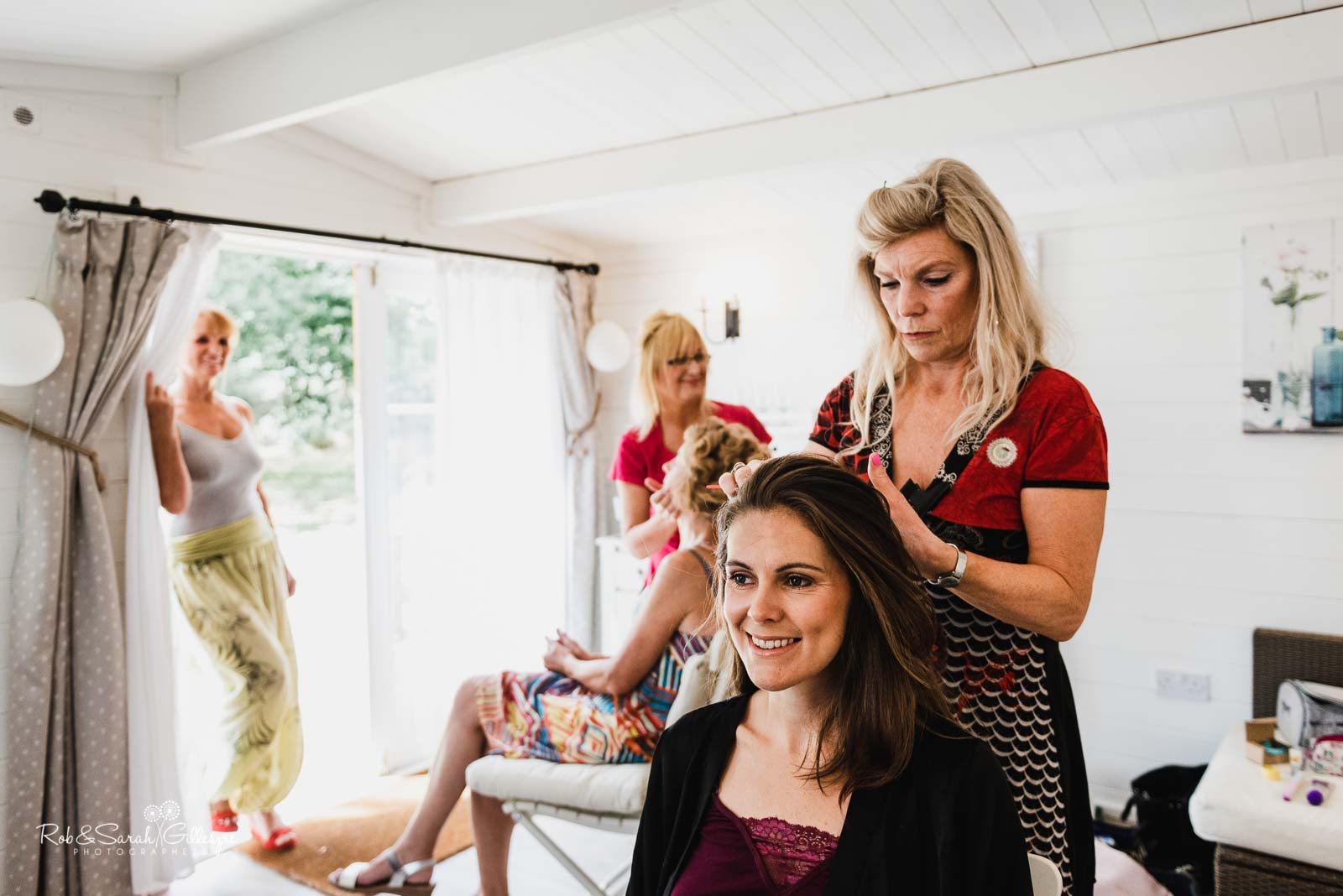 Bride has hair styled at Wethele Manor