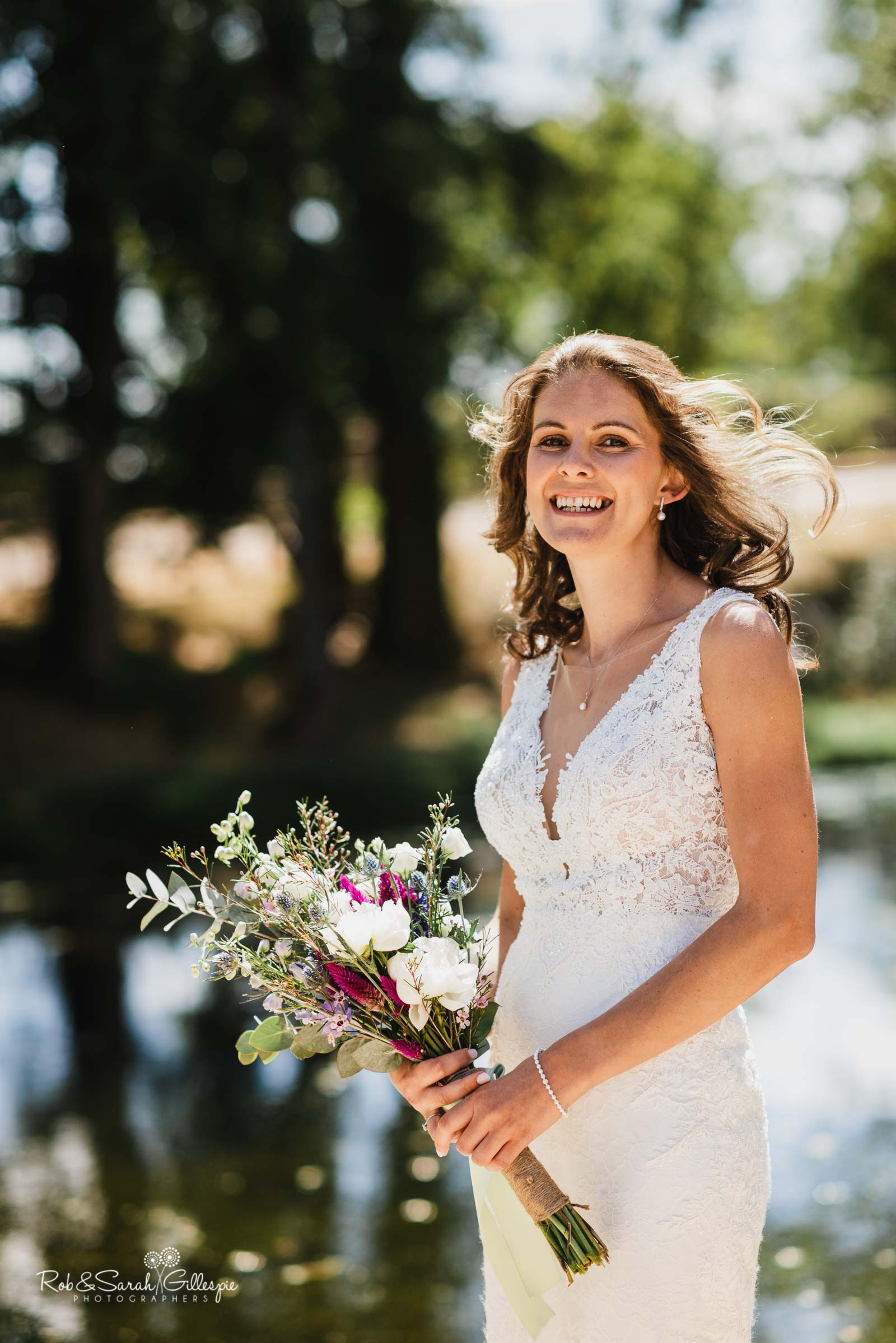 Bride smiling for portrait at Wethele Manor