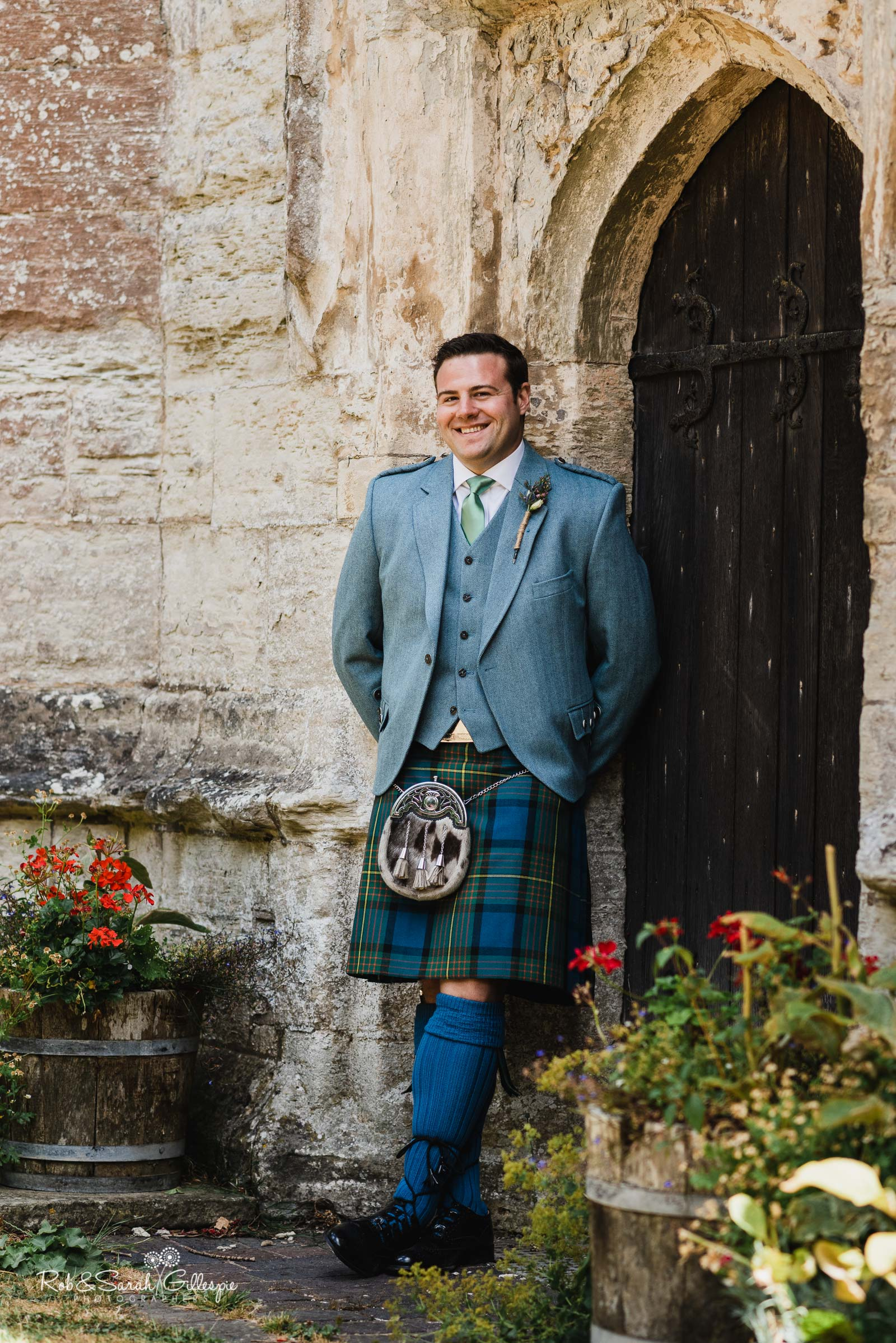 Groom portrait at St Giles church Packwood