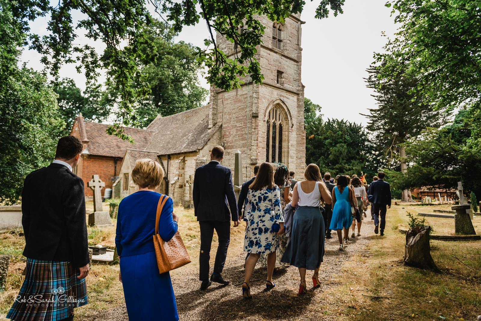 Guests arrive for wedding at St Giles church Packwood in Warwickshire