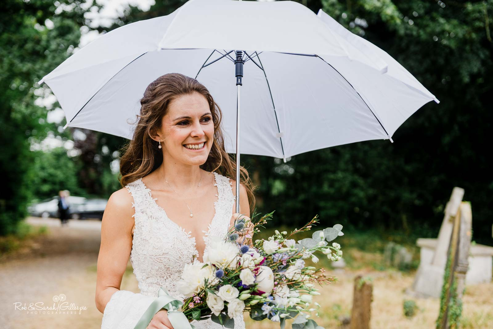 Bride arrives for wedding ceremony at St Giles church Packwood