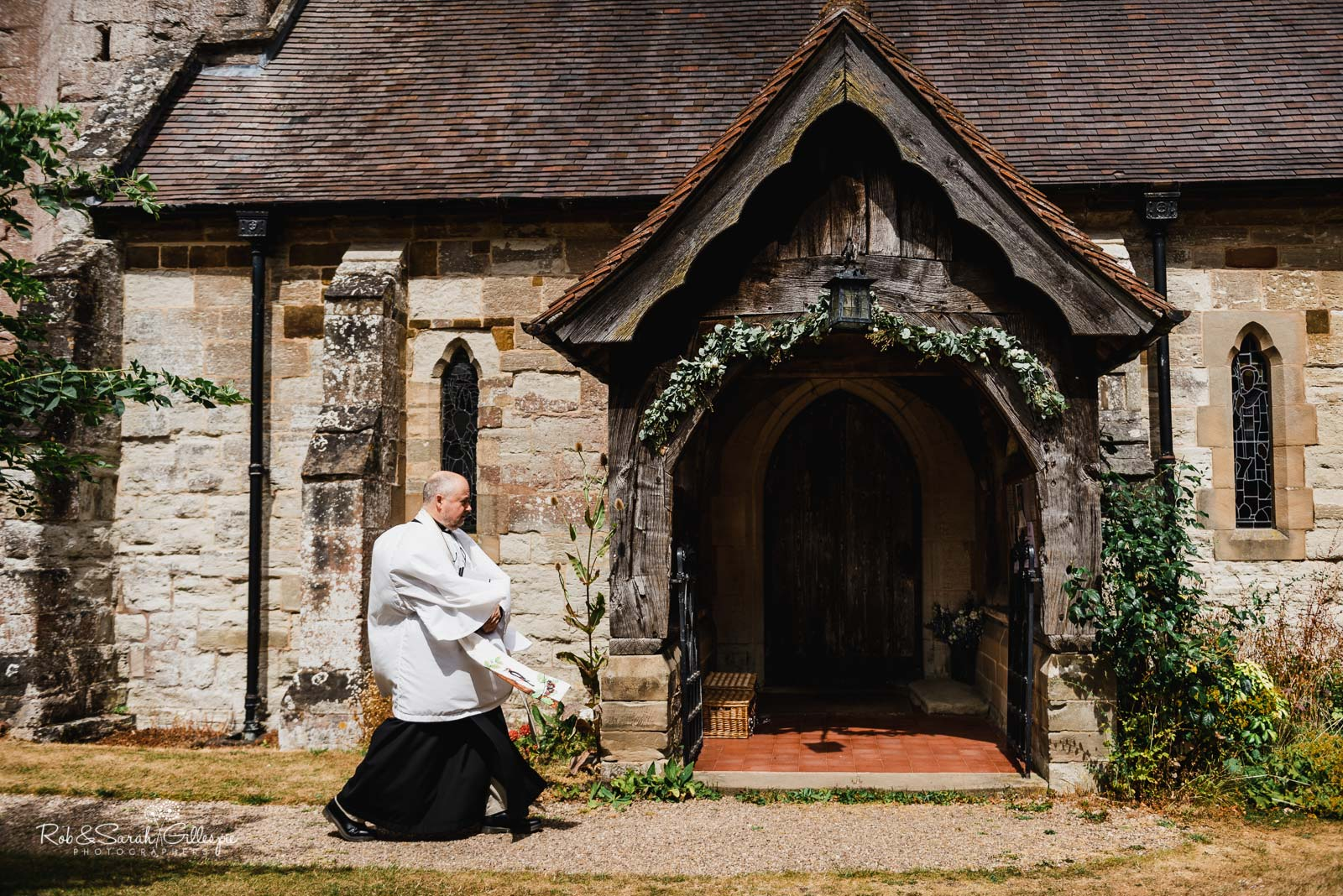 Vicar arrives for wedding at St Giles church Packwood