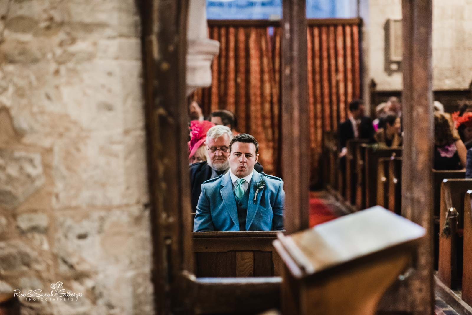 Groom waits nervously at St Giles church Packwood