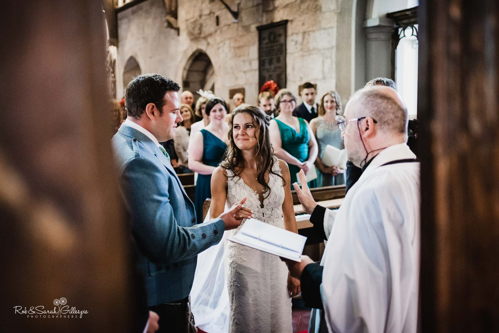 Wedding ceremony at St Giles church Packwood